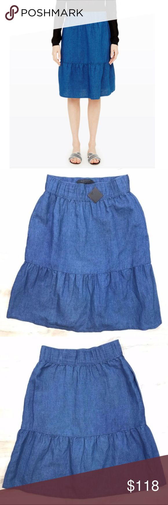 Club Monaco Collection Blue Velda Denim Skirt * Club Monaco Collection Women's Blue Velda Denim Skirt, Size 00 * New with tag  * A modern, urban take on the prairie skirt crafted from lightweight denim in a rich indigo hue.  * A Club Monaco Collection piece.  * Linen/cotton blend. Elastic waistband.  * Pleated, tiered skirt.  * Ruffle hem.  * Hidden pockets at side seams. * 54% Linen, 46% Cotton * MSRP $349.00   * Size 00 - Approximately 13 inches waist and 23 inches total length Club Monaco…
