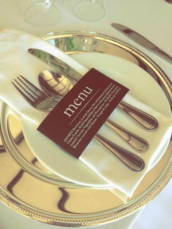 silver charger plates with crisp white linen and great printed menu napkin holder