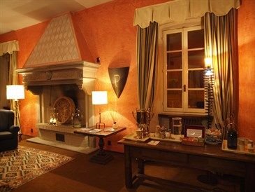 Lounge room with antique fireplace and coffe and tea machine