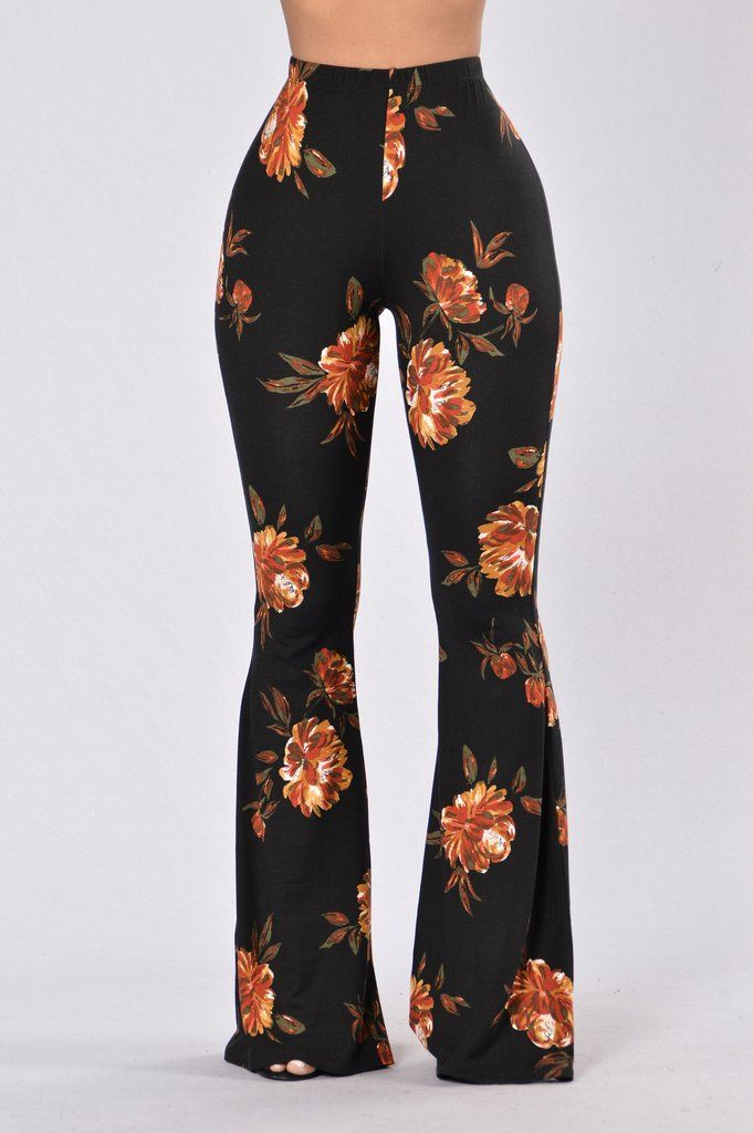 - Available in Black, Floral Black, and Floral Burgundy - Floral Print Pants - Flared Bottom - Elastic Waist Band - Made in USA - 96% Polyester 4% Spandex