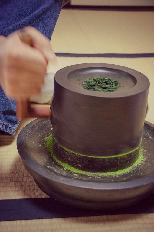 Learning the traditional art of hand grinding matcha tea. At Nakamura Tokichi Honten in Uji, Japan.