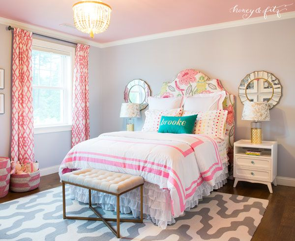 We love the pop of light pink on the ceiling and touches of gold in this big girl room!
