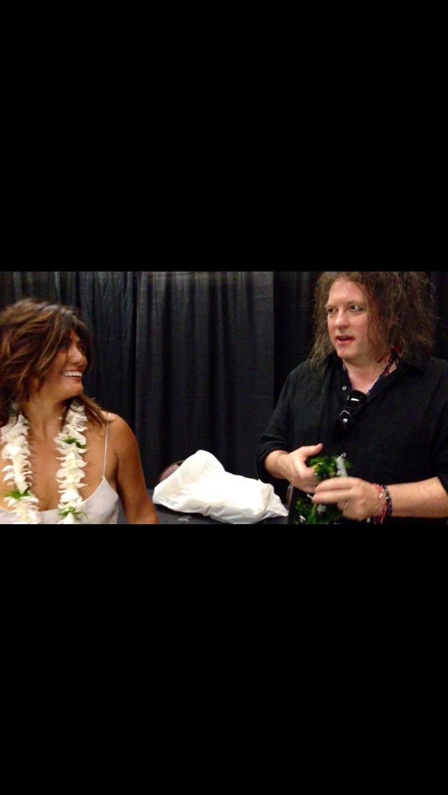 Veronica Grey and Robert Smith of The Cure share an aloha moment tonight