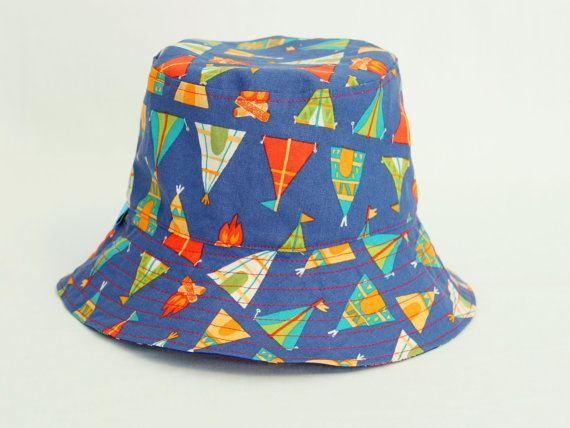 Dinosaurs and TeePees childs bucket hat has been handmade with love and attention to detail by One Crazy Mumma. It is made to order in sizing of