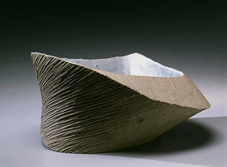 """Glazed Dish - Hoshino Kayoko 2006 By hand-pinching and slicing her clay with wires, Hoshino """"releases"""" the forms within the clay to create silhouettes and shapes inspired by the mountain peaks and boulders from the natural landscape of rural Japan."""