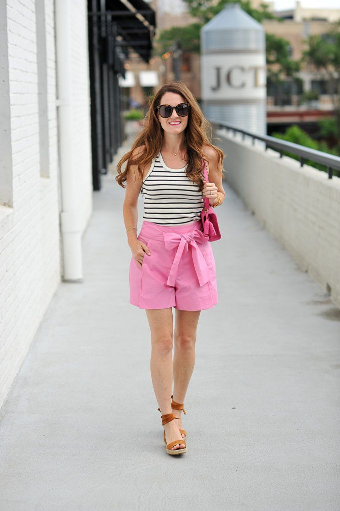 Pink shorts outfit for summer via Peaches In A Pod blog. Women's summer style. J. Crew pink tie waist shorts.