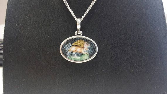 Check out this item in my Etsy shop https://www.etsy.com/uk/listing/481366123/micro-mosaic-pendant-of-the-chimaera