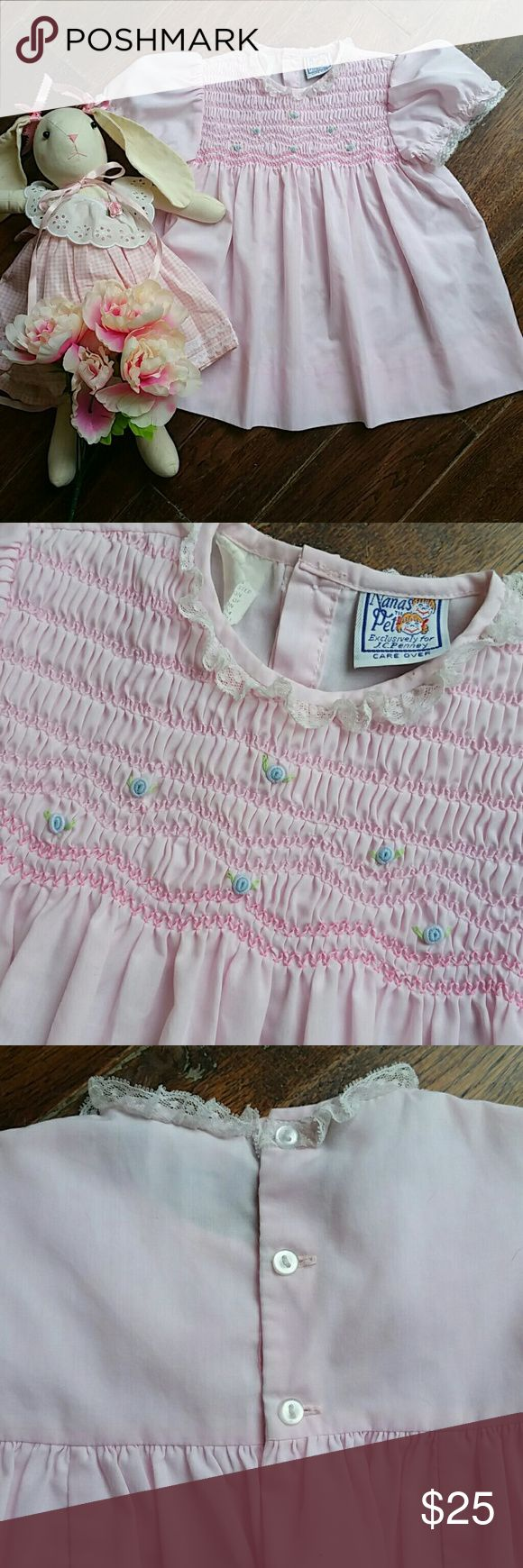 Pink smocked dress A cute little vintage pink dress with beautiful smocking  and little blue roses adorn the neckline delicate lace trimming the big puffy sleeves and neckline. Vintage Dresses