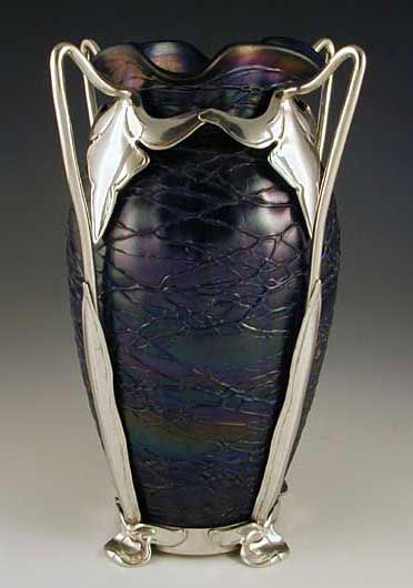 Irridescent glass vase with polished pewter Art Nouveau mount