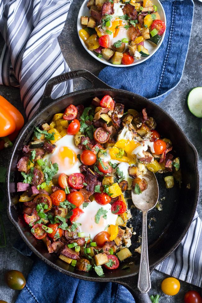 This one-pan sweet potato hash is loaded with summer veggies, bacon and served with or without baked eggs - your choice!  It's delicious, filling and healthy any time of day making it perfect for breakfast, lunch or dinner.  It's paleo, whole30 friendly and low FODMAP too.