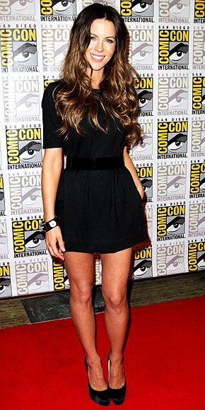 KATE BECKINSALE shows off her dark side in a Tibi LBD, Isharya bangle and satin Jimmy Choo pumps at Comic-Con in San Diego.