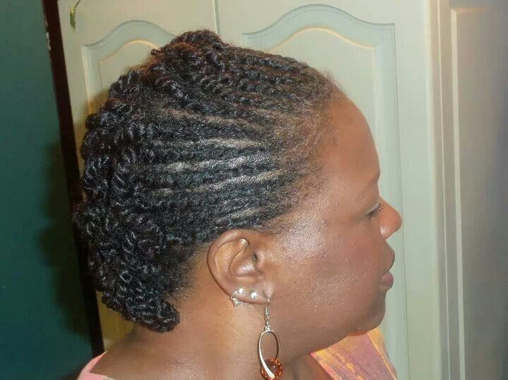 Two strand flat twisted to the back in a semi mohawk style.