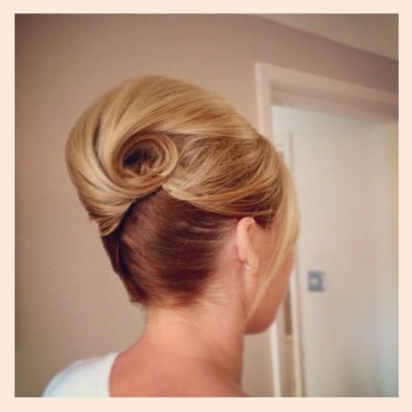 Gorgeous swirled french roll updo on blonde hair