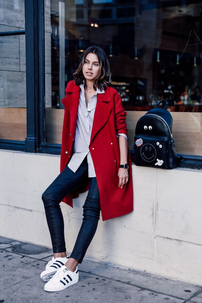 sneakers with wool coat and skinny jeans