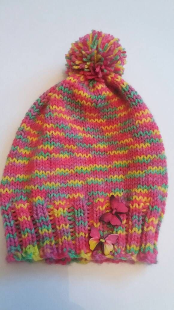 Baby multi coloured knitted pom pom hat by redrosehandmade on Etsy