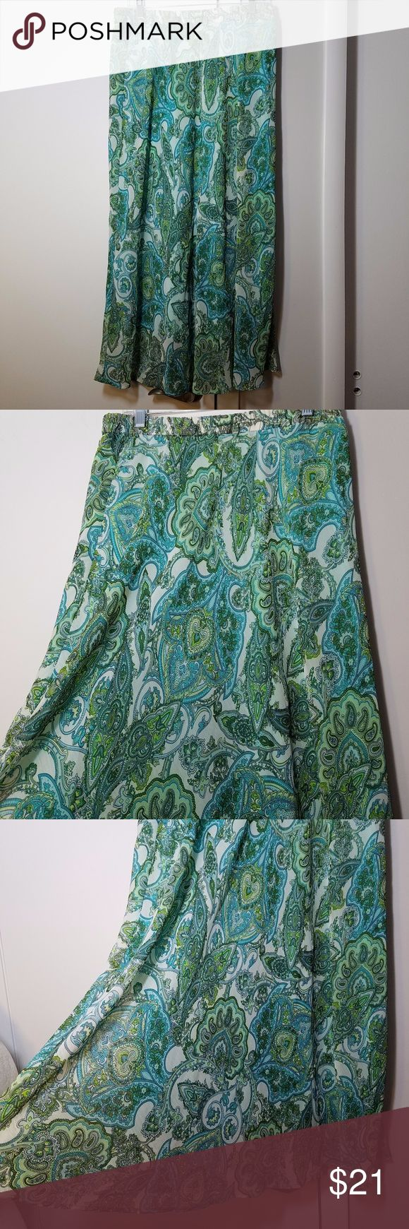 Roz & Ali Paisley Gypsy Maxi Skirt Excellent condition. Like new! I never got around to wearing this skirt. Features blue & green paisley patterns throughout. The waistband is very stretchy, the skirt is quite flowy and light with a solid turquoise liner layer underneath. Approximate measurements are in the picture. 100% polyester. Roz & Ali Skirts Maxi