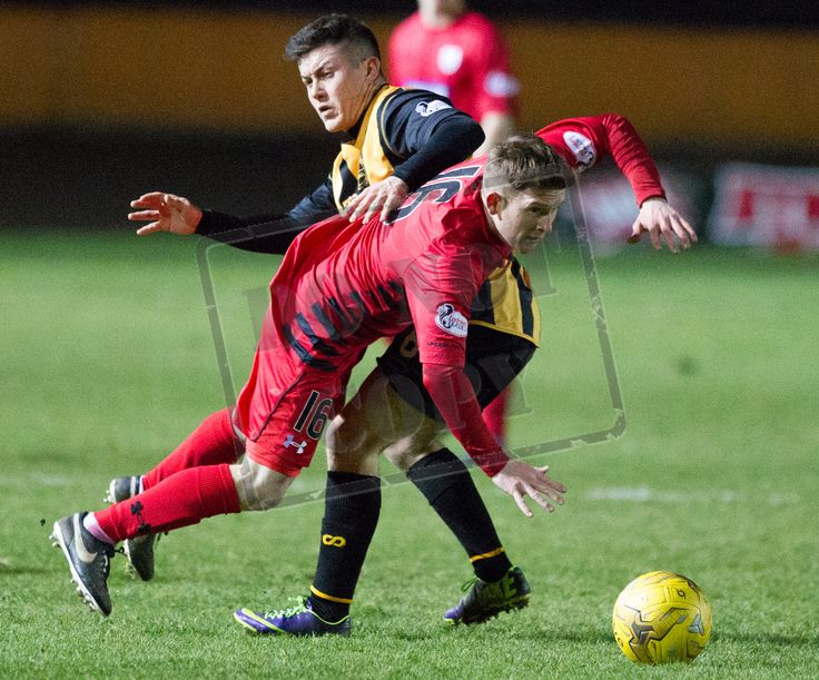 Queen's Park's Joe Bradley is tackled during the SPFL League Two game between Berwick Rangers and Queen's Park.
