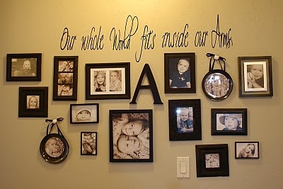 Family photo display - I like the idea of having family member's initial scattered among the photos