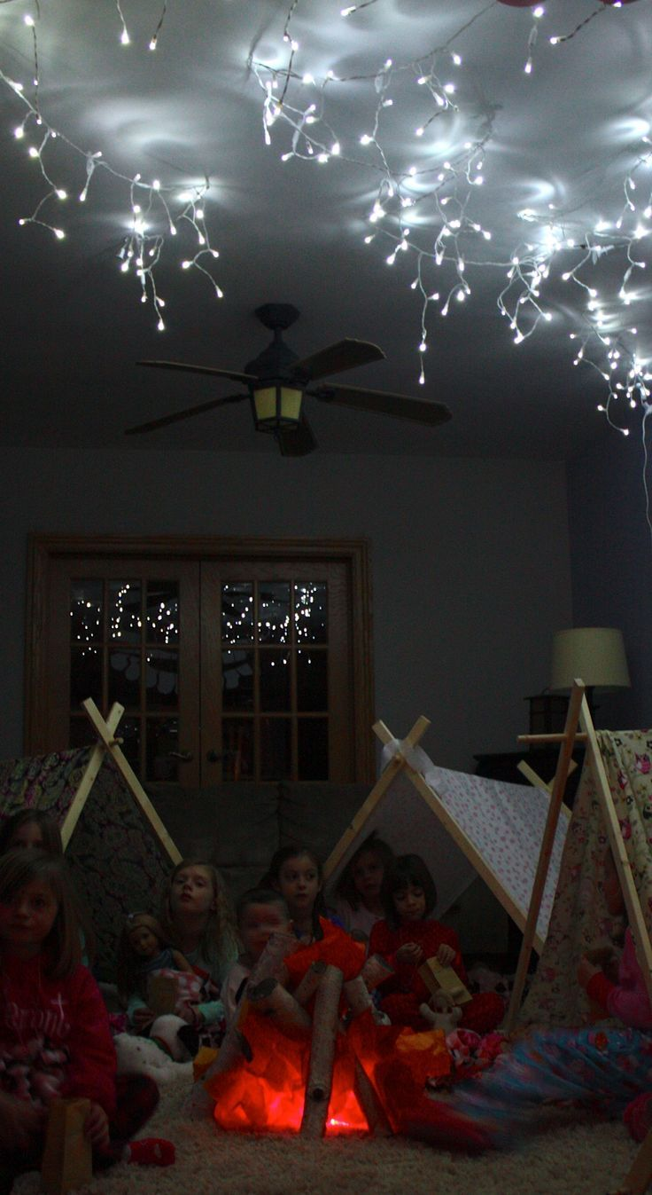 "Aww this would be a great birthday party if you had a kid born in the winter. Indoor camping party - sleeping under the ""stars"" :)"