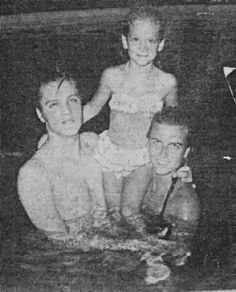 This photo was published in the Tupelo-Lee County Tribune on August 9, 1956. It was taken in the private swimming pool of the Sun 'n Sand Seaside Motel near Biloxi, MS in July 1956 and shows Elvis and his girlfriend June Juanico together with eight-year-ol