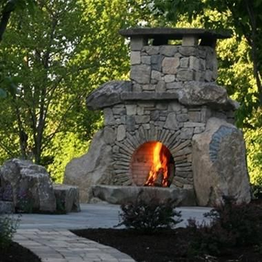 This massive fireplace was constructed of natural boulders and New Jersey fieldstone. Love the circular opening and it's radiating stonework.