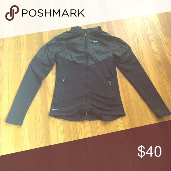 Nike running jacket Worn a few times but you would never be able to tell.  Super cute light jogging jacket. Nike Jackets & Coats