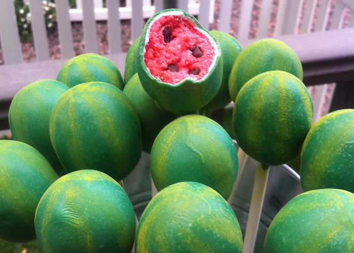 Watermelon cake pops - dip in white chocolate first, then green candy melts, then lime green color dust to make stripes.