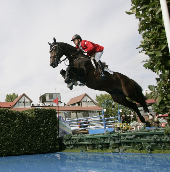 Great shot of Eric Lamaze and Hickstead...what a neck and body stretch! Can't wait for the day I can confidently do such a jump on my Lulu!