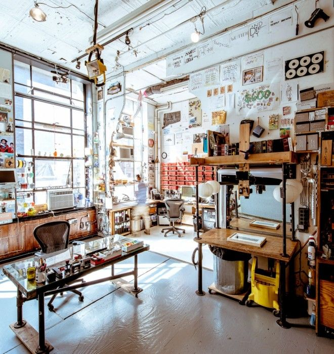 Just outside Neistat's office is his fully-functional mini-movie-making studio. There's a workshop, an overhead rig for shooting titles and animations, and a work space for several assistants. The desk on the left was built from a salvaged WWII ship door. ~atelier d'artiste~