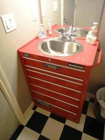 Man's metal toolbox as bathroom sink vanity