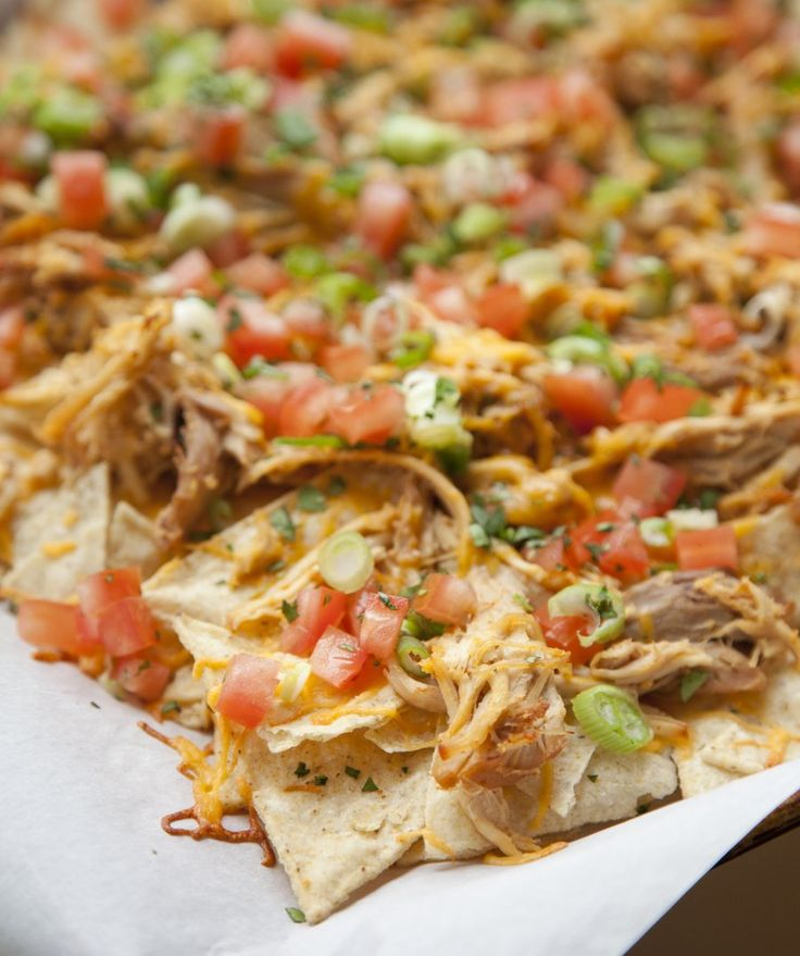 Nachos topped with Slow Cooked Shredded Chicken! http://www.urbancookery.com/shredded-chicken-nachos/