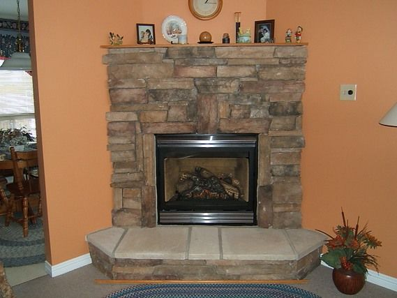 Decoration corner stone fireplace designs interior Corner rock fireplace designs