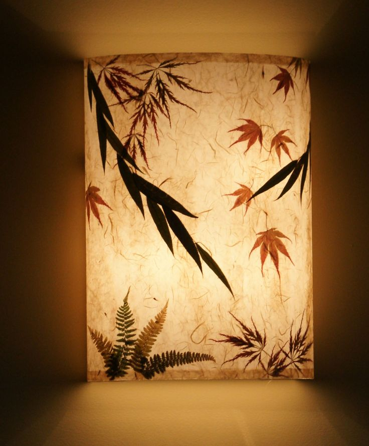 www.AmbientArt.com   wall sconces made to order - specialty papers - individually pressed leaves - custom sizes for direct wiring or available on a cord with a plug & toggle on/off.