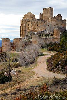 """CASTLES OF SPAIN - Castillo de Loarre es el castillo fortificado más antiguo de España y quizás el mejor conservado en Europa de estilo románico. Su construcción se remonta al siglo XI y está situado en la cima de la sierra de Loarre a 30 km de Huesca. Ha sido escenario de muchas películas y su imagen se ha hecho famosa en todo el mundo. Un ejemplo de ello es el rodaje de la película """"El reino de los cielos"""" en 2003."""