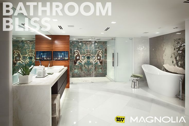 Get ready in style. This bathroom features three zones of audio which includes a dedicated zone just for the shower. With TVs for each vanity, this couple can enjoy their own personal shows or music while getting ready for work or a night on the town.