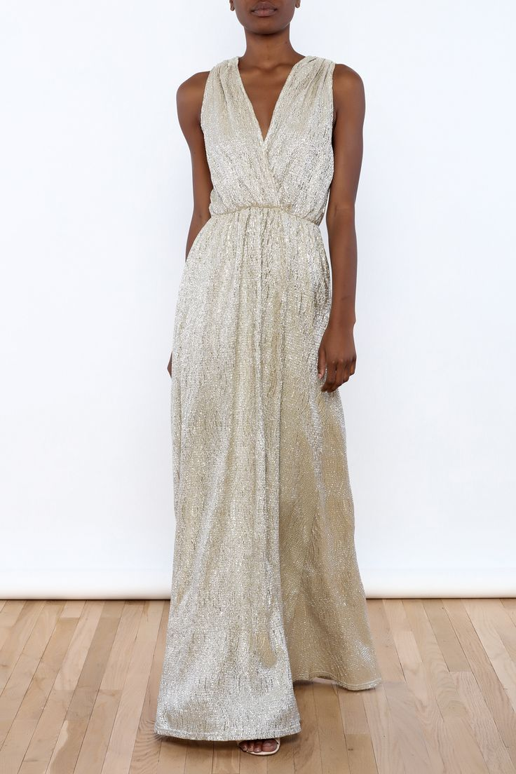 Metallic sleeveless pleated maxi dress with an elastic waist and crossover top.   Pleated Metallic Maxi Dress by Alythea. Clothing - Dresses - Maxi Manhattan, New York City New York City