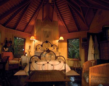 ROMANTIC Jamaica, Caribbean: A bedroom in the Royal Palm villa at the Goldeneye