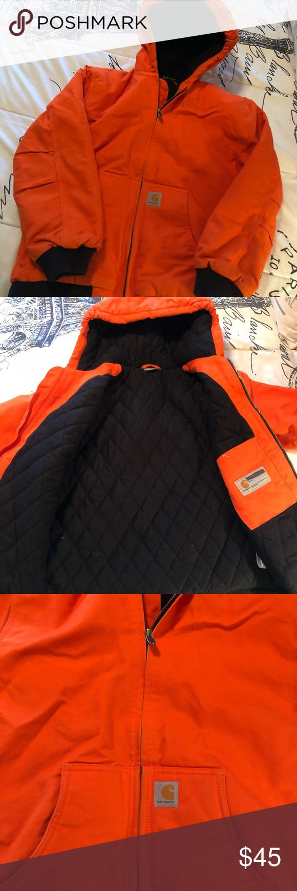 Boys Carhartt Winter Coat Very heavy thick warm winter coat! The typical carhartt heavy duty material with interior quilting for extra warm! This coat is in great condition. Small mark on the back see last photo. Carhartt Jackets & Coats