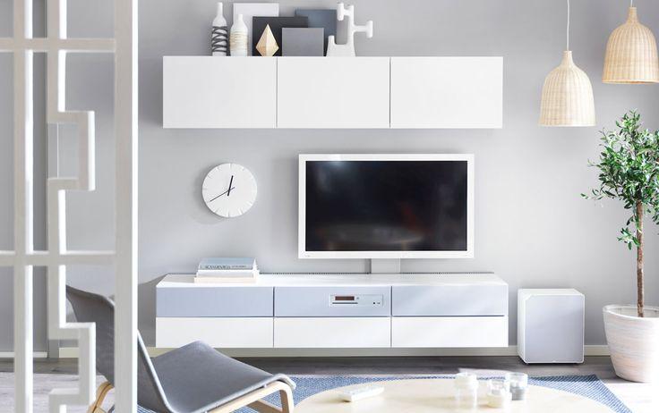 """Combinazione BESTÅ/UPPLEVA con mobile TV e scaffali bianchi, e TV a LED da 40"""""""