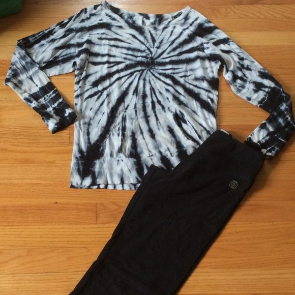 The balance collection Gently used in great shape!  Adorable to wear for a yoga session, gym workout or running errands....Color is black and white with a hint of blue.   Very light weight long sleeve with a front pocket and pants have fold over top. Price includes this as a set! Pants Leggings