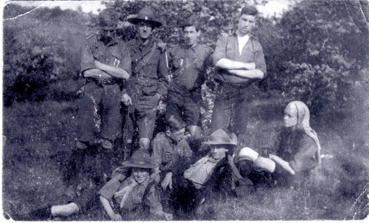 My father in front row with scout hat. His Scoutmaster (Captain) Stanley Joseph Docking Berger is standing in back row.