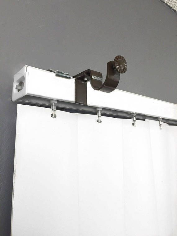 Easily hang curtains and dramatically change the look of any room by attaching this bracket to your outside mounted vertical blinds. Outside mounted vertical blind head rail attachment Fits up to 1 inch curtain rod No Brackets to screw in the wall No Drilling, No Hammering Set of 3 Brackets Color - White  Important: Please ensure your existing blind head rail is securely fastened to the wall.  1. Remove valance if present.  2. Slide the bracket over the vertical blind head rail.  3. Adjust…