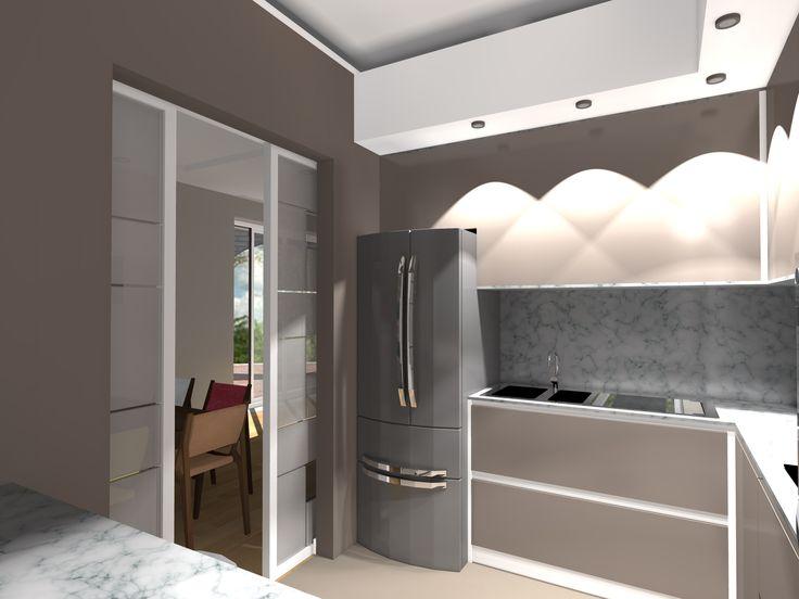 La porta a vetri scorrevole permette un dialogo non visivo e funzionale con la zona del living occupata dal tavolo da pranzo