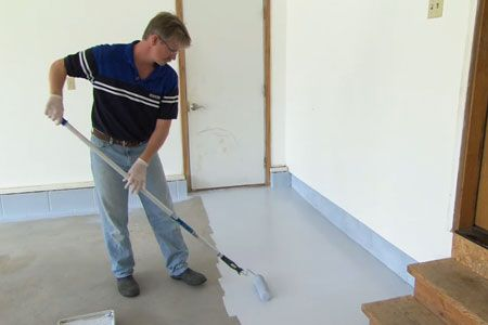 This Old House host Kevin O'Connor assists epoxy-coating expert Doug Fasching in creating a good-looking, hardwearing, stain-resistant garage floor.