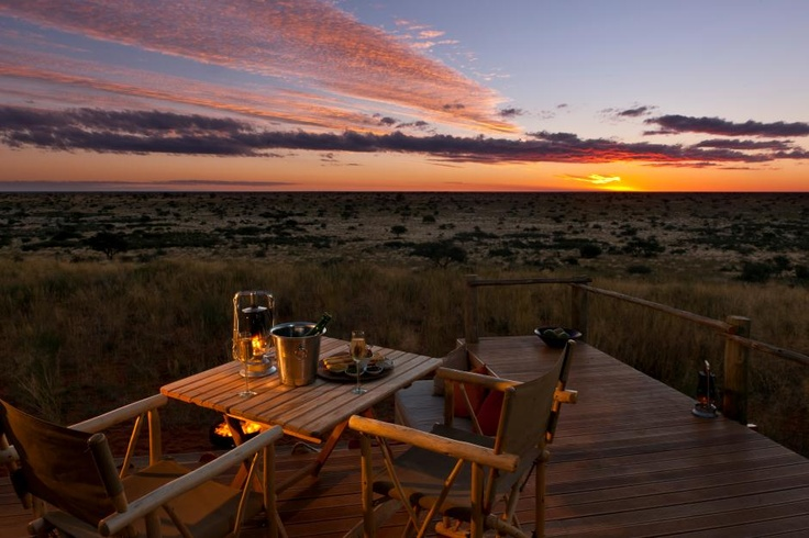 When you choose to 'sleep out' at Tswalu, the Kalahari provides it's own entertainment, of the truly breath taking kind - sunset is quite a spectacle. (Tswalu Kalahari Reserve, Northern Cape, South Africa)