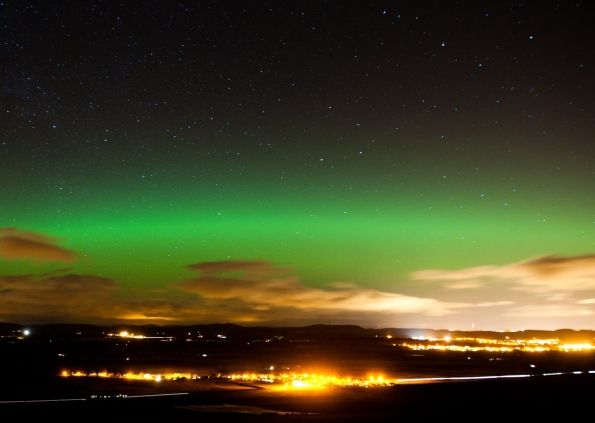 Dundee with the Northern Lights Overhead