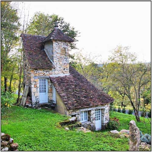 Wouldn't you love to go inside here and what it looks like? It's unique and cute, darling, adorable!
