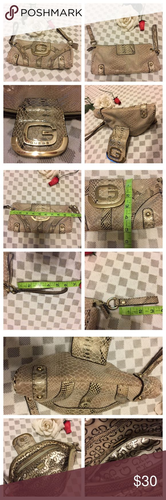 ***Guess***Snake Like Skin Clutch ***Guess***Snake-like Skin Clutch. Inside you have an inner zipper and one wall pocket. Size is as seen in photos attached here. Please see minor imperfection in photo - cratch on G hardware in front of bag and brown mark at zipper ends not seen after zip-up. Nonetheless, clutch is very clean. No hold and No trades. Guess Bags Clutches & Wristlets