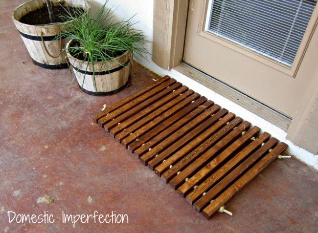 Wood and Rope Mat.  Just use 2x2's and rope (I might go with nylon so it doesn't deteriorate).  Tie a knot between each piece.