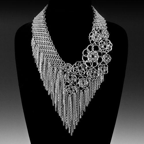 Bib-style layered chainmail necklace. A visual style which beaders and textile artists have long ruled over, now in rings!